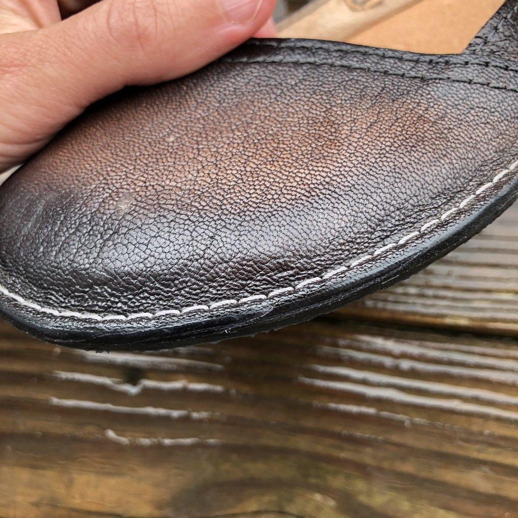 A closeup of top stich on Gea Soles barefoot ballet flats.