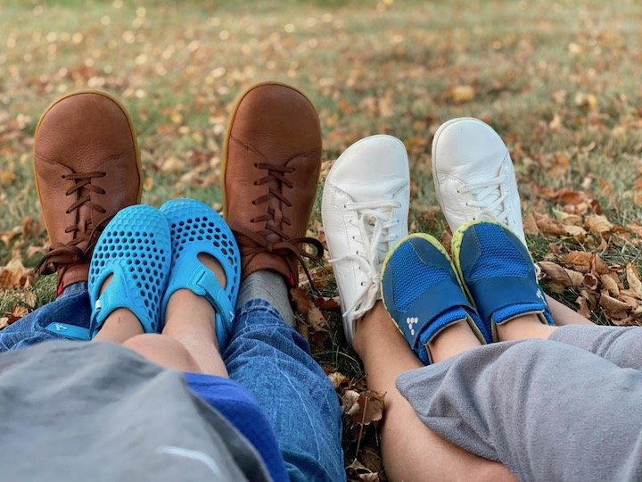A family wearing vivobarefoot barefoot shoes, two kids and two adults.