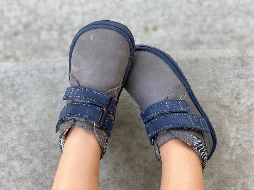 A close up of a kid's feet wearing Be Lenka minimalist play shoes