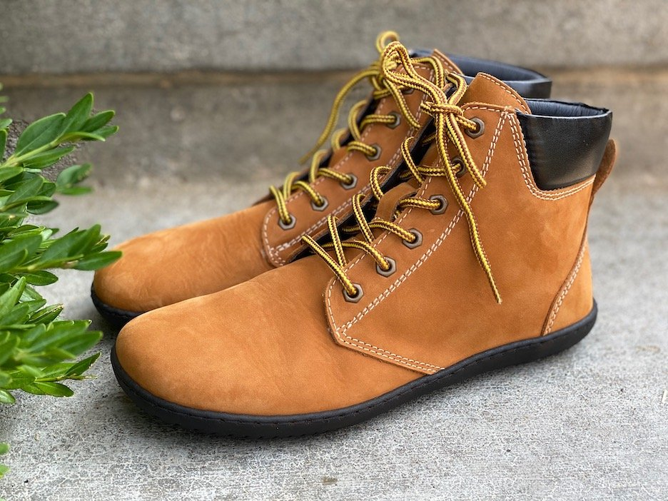 A close up image of a pair of the Groundies Liverpool Urban barefootwear boot in brown sitting on the ground side view