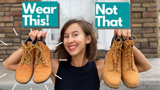 """An image of a woman holding up two pairs of boots, the Groundies Liverpool barefoot boots and Timberlands with the text """"wear this! Not That"""" over the top"""