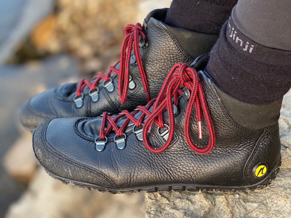 a close up of a pair of feet wearing the Joe Nimble wandertoes in black leather for the best barefoot minimalist hiking boots review