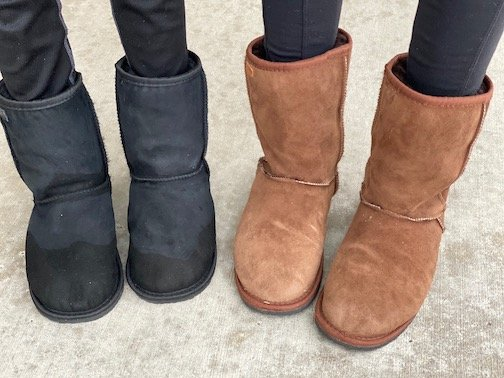 two pairs of feet wearing Zeazoo Kids Dingo boots, barefoot sheepskin winter boots for kids and adults.
