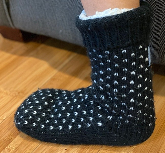 a foot wearing a barefoot approved slipper sock