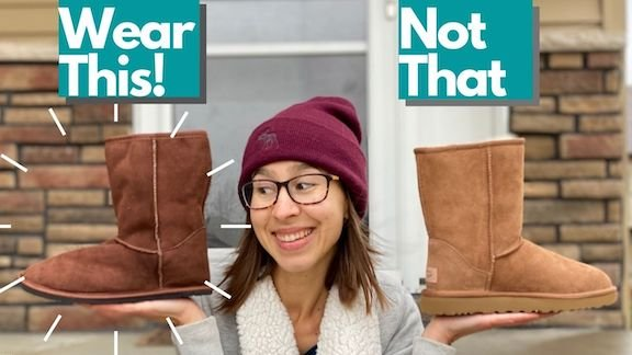 A woman in a winter hat holding 1 boot in each hand. She is looking at Zeazoo Kids Dingo boot and is turned away from the pair of Uggs.
