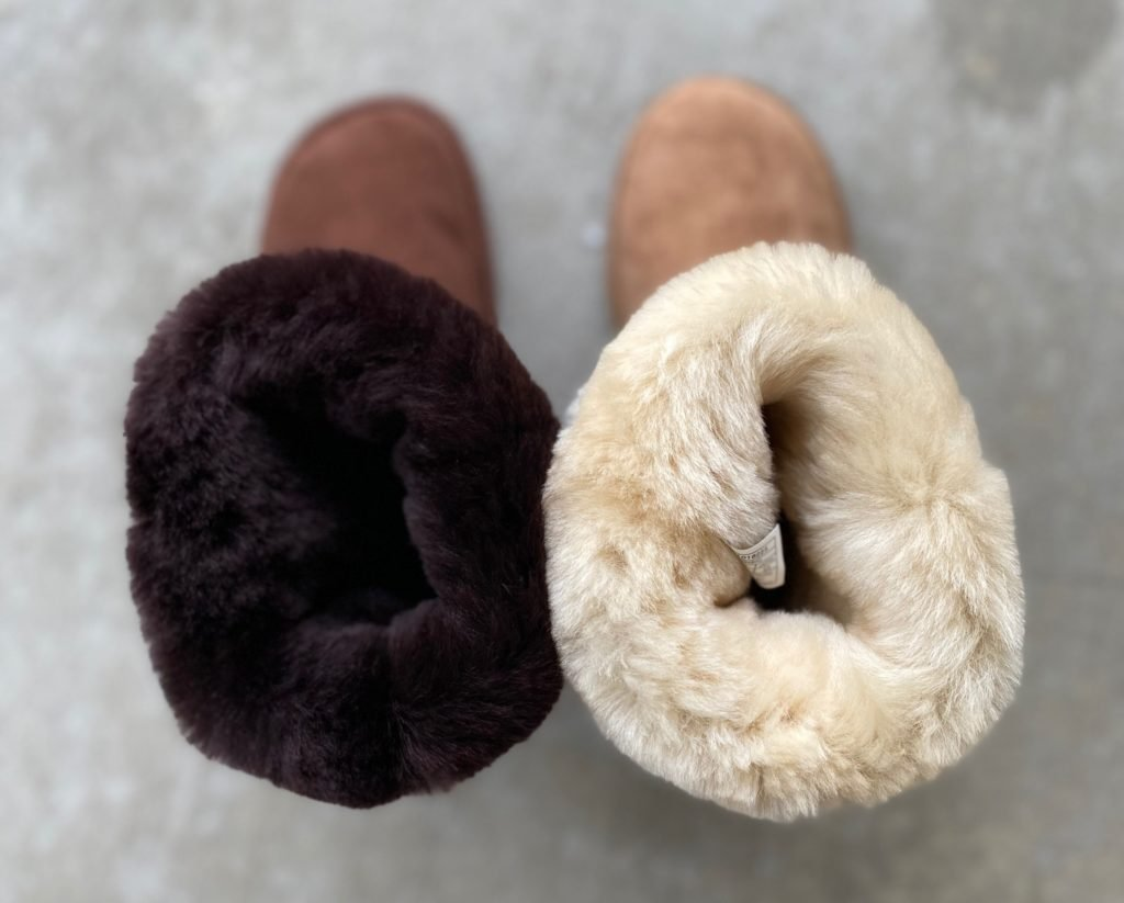 A side by side of the Zeazoo Kids Dingo barefoot boot next to the Uggs classic boot to show that both are fully lined with fuzzy warm sheepskin
