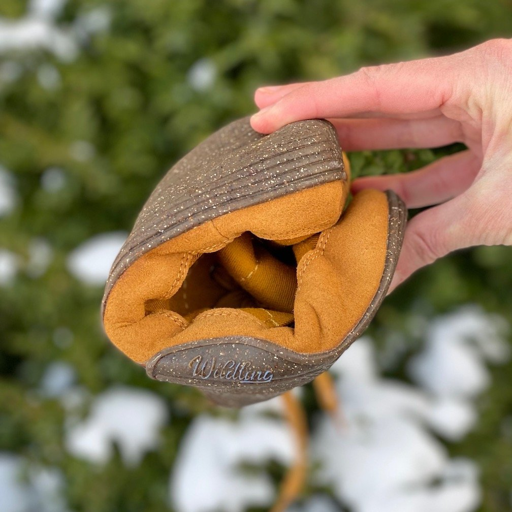 Wildling Honeybear winter shoes folded up to show the extreme flexibility