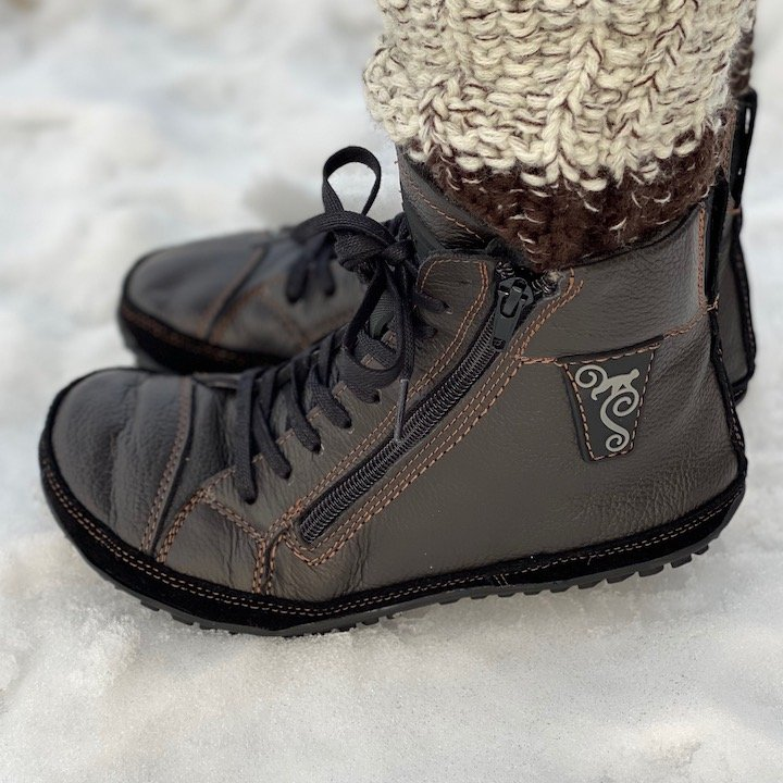 Close up side view of the Magical Alaskan side zipper barefoot flexible winter boots.