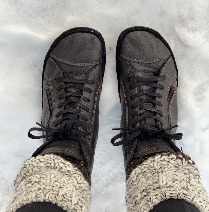 Top view of a woman's feet in Magical Alaskan barefoot winter boots in brown leather