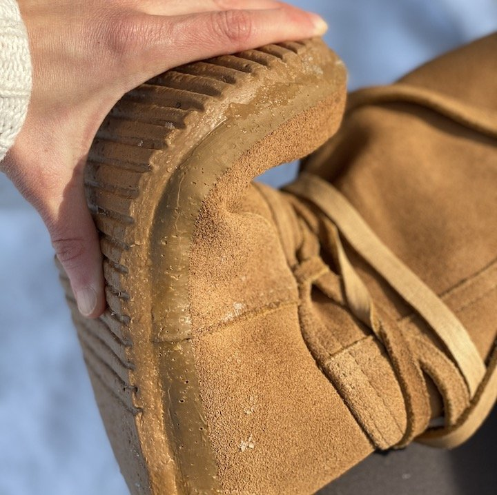 a close up of the flexible rubber outsole of the steger mukluks barefoot winter boots