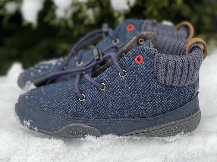 Wildling Nessie wool barefoot boots with elastic laces in the snow