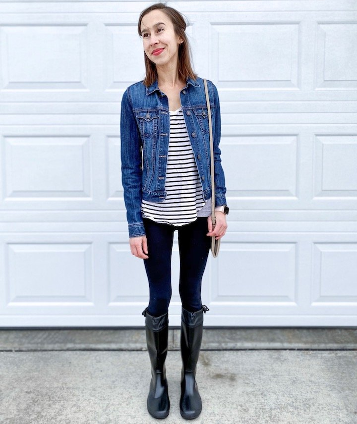 A woman in a striped shirt and jean jacket wearing a pair of Asgard Rainboots