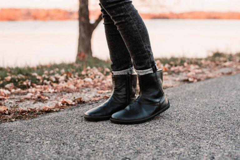 A woman's legs in Be Lenka Polar black leather barefoot winter boots outside