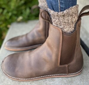 Close up side view of waxed brown chelsea boots by DaVinci.