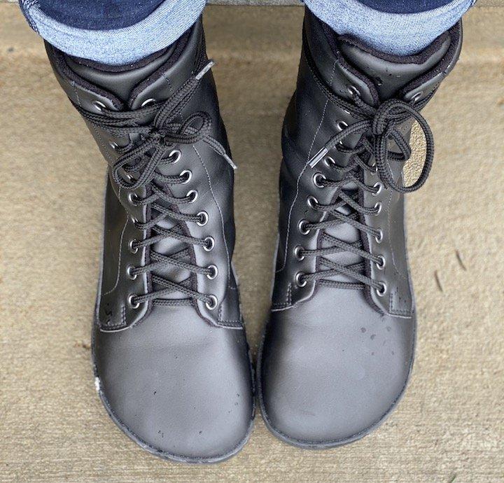 Top down view of a pair of feet wearing Ahinsa Jaya Black Vegan Barefoot Combat Boots