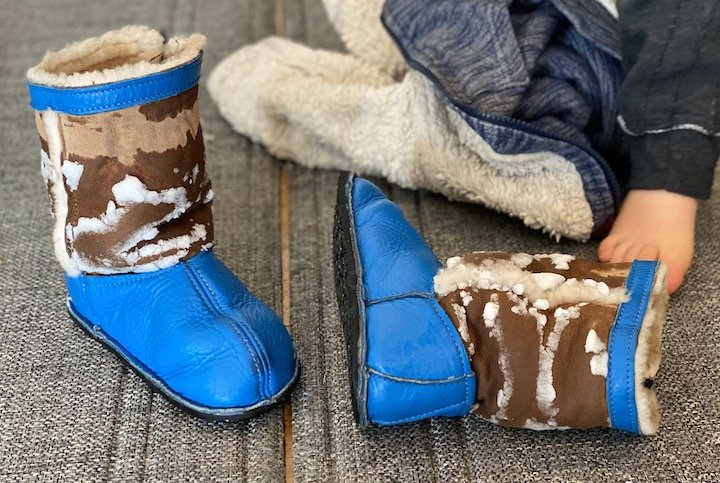 A pair of snowy softstar Phoenix barefoot boots for kids