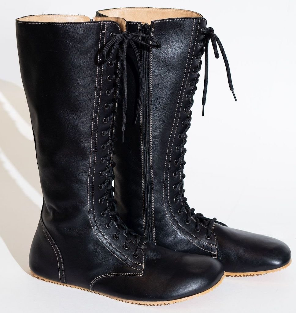 A stock image of a pair of No(N)s tall black leather lace up barefoot combat style boots.