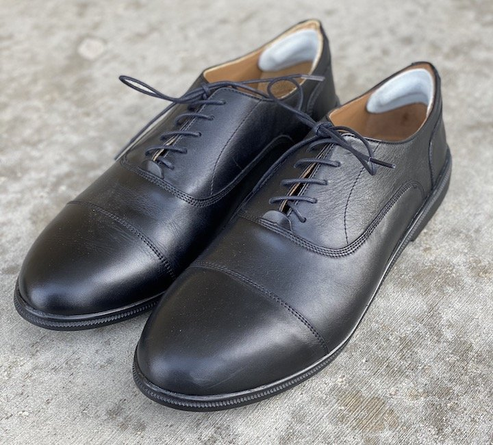 A close up angled view of the best dressy barefoot shoes for men. Caret's brand.