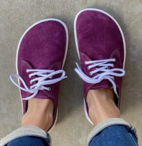 A stunning pair of plum Be Lenka City sneakers with white outsoles and laces.te outsole and white laces.