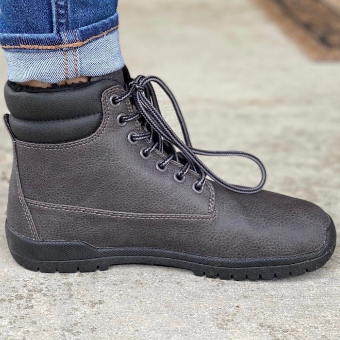 A side view of a high volume foot wearing Feelgrounds patrol Winter boot.