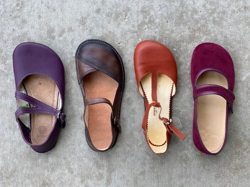 A top view comparison of 4 popular barefoot flats. Left to right brands are Softstar, Gea Soles, ZlaTush, and Tadeevo.