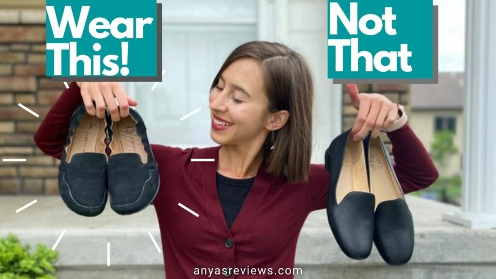 A woman holding up two pairs of black loafers, She is looking at the pair on the left, Lisbeth Joe London zero drop minimalist loafers, The text reads, Wear This Not That anyas reviews dot com
