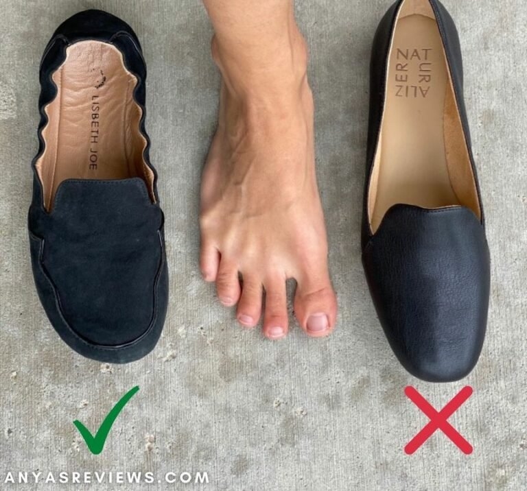 Annotated image showing a wide bare foot between Lisbeth Joe London Loafers and naturalizer conventional tapered heeled loafers that deform your feet.