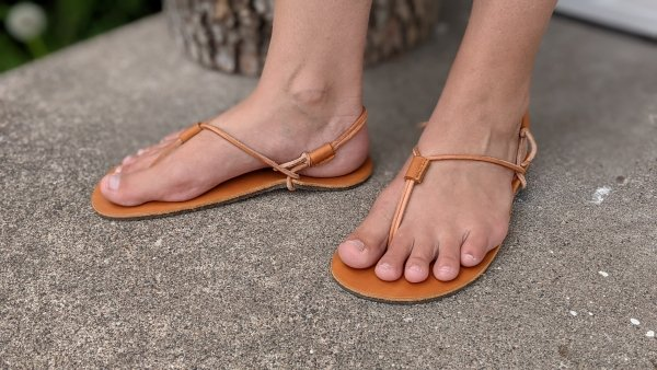 Close up of Chala Antique sandals being worn by a woman with extra wide feet