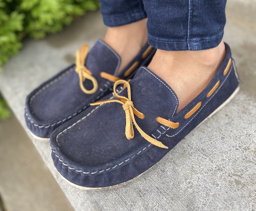 Close up angled view of Zeazoo Cheetah barefoot moccasin style loafers in navy. They are very lightweight and flexible.
