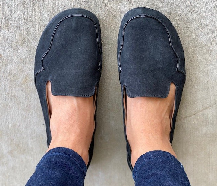 Top down close up of a woman's feet in Lisbeth Joe London Loafers.