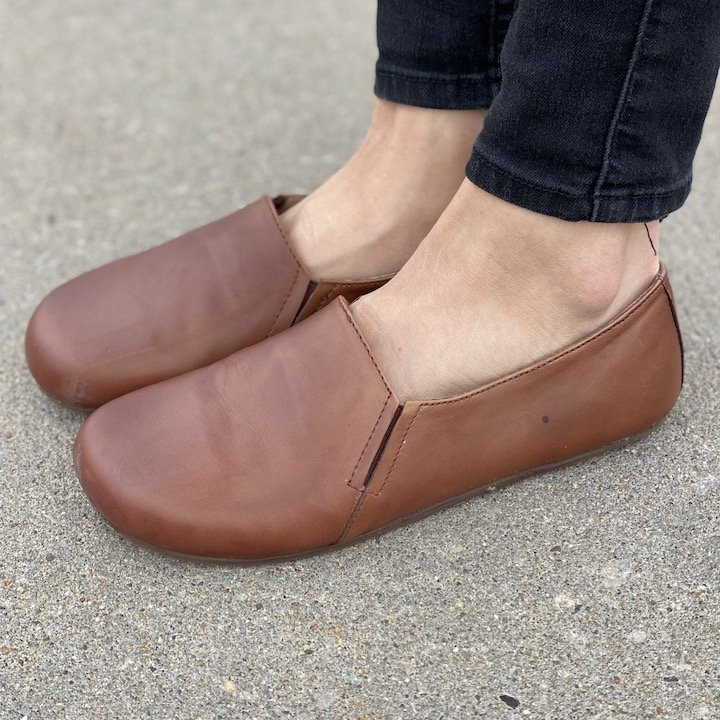 A front angled close up of FeetSutra Khussa brown leather loafers.