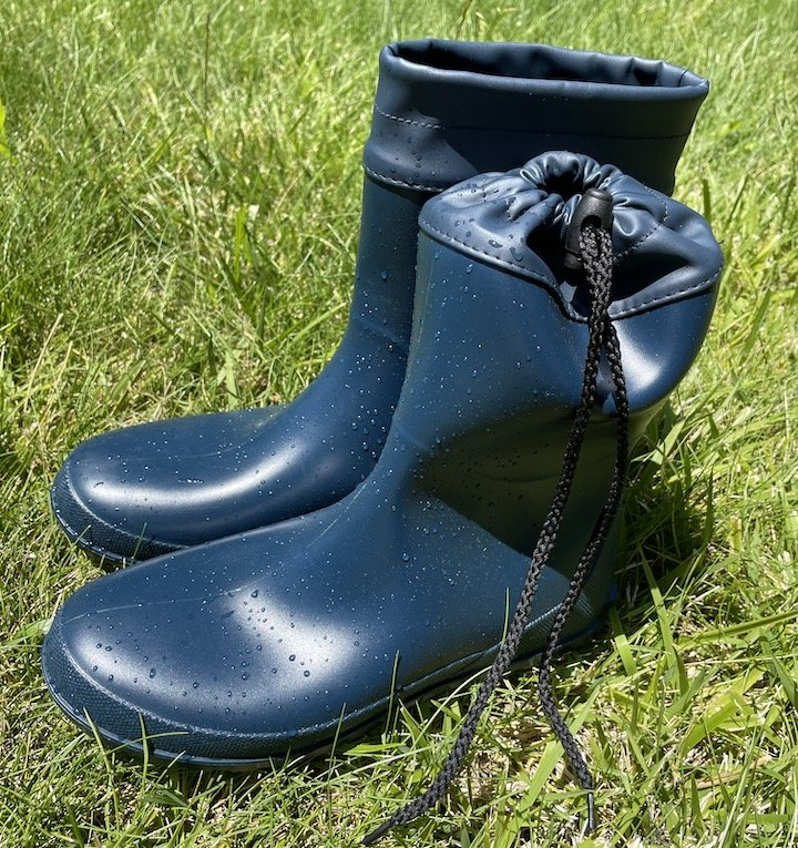 Close up of wet navy blue Asgard rubber boots