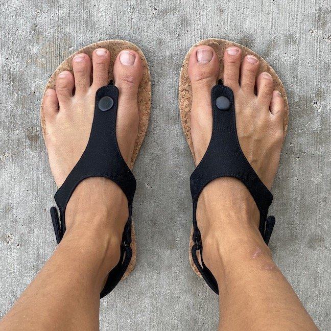Top down view of Feelgrounds barefoot seaside sandals in black