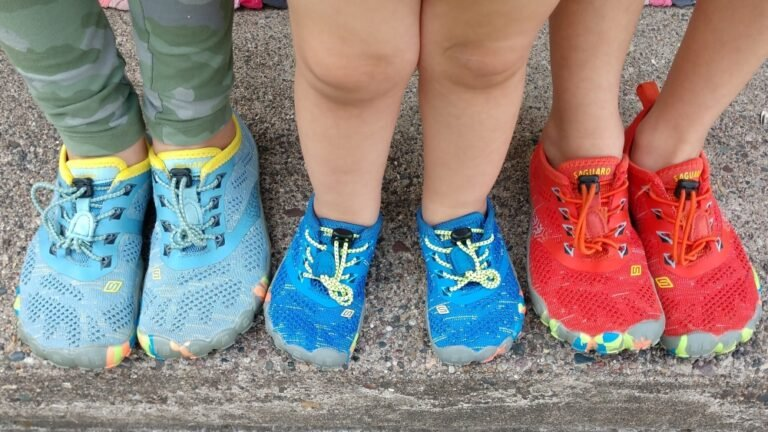 Top down view of 3 children's feet in Saguaro inexpensive Amazon shoes that are barefoot friendly.